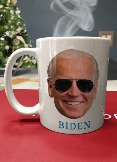 Cup of Joe XMAS Funny Christmas  Funny Political A photo of a coffee mug with a picture of Joe Biden's face on it. | Joe Biden president elect election coffee merry Christmas sunglasses hot funny political democrat vote votes tree presents mug At the Holidays, there is nothing like a Hot Cup of Joe!